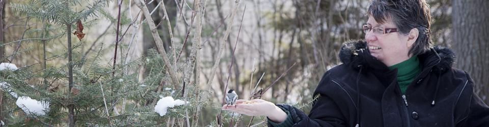 Cindy Crowe with a chickadee